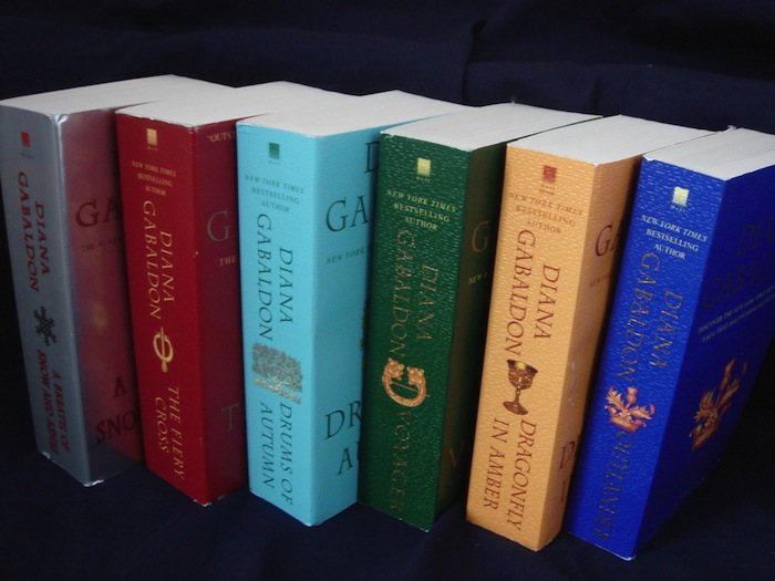 I could never hold one of these books without my hands cramping up into arthritic claws. But thanks to the Kindle App, I can read them ALL DAY LONG. (Since I don't own the paper books, I had to get this picture from reelscotland.com, so thanks to them)
