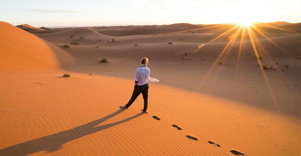 Sunburst in the Sahara desert, Erg Chegaga, Morocco, Africa