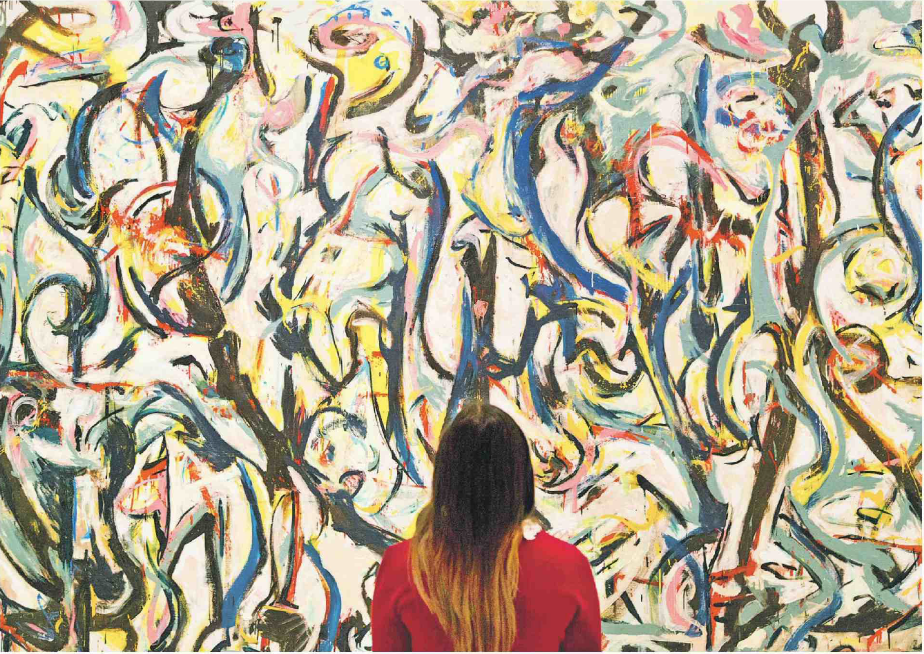 A woman looks at 'Mural' (1943) by Jackson Pollock at an exhibition at the Royal Academy of Arts last year.    PHOTO: ALAMY
