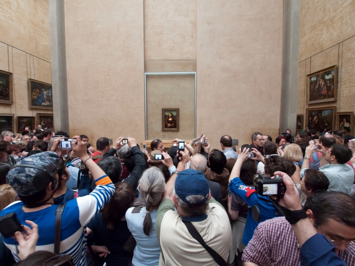 Crowd of tourists trying to see the Mona Lisa by Leonardo da Vinci at the Musée du Louvre, Paris.  (photo: Iain Masterton / Alamy Stock Photo, courtesy Prestel)