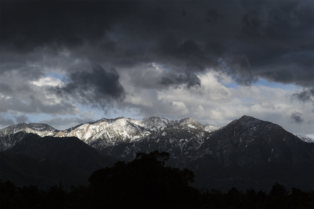 wasatch-front-from-salt-lake-city-stormy-snow-cloud-may.jpg