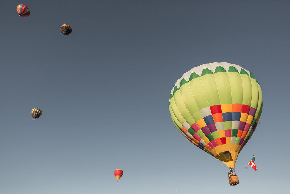 hot-air-balloons-salt-lake-city-summer-blue-sky-colors-flags.jpg