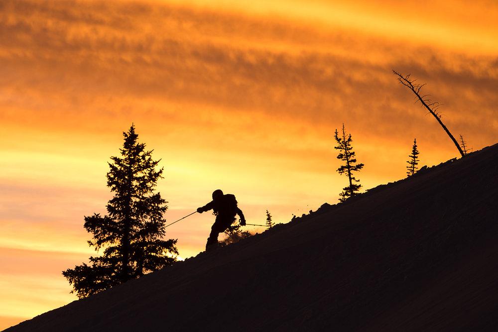 derek-salomonson-sunset-skiing-little-cottonwood-canyon-patsy-marley-clouds-orange-silhouette.jpg