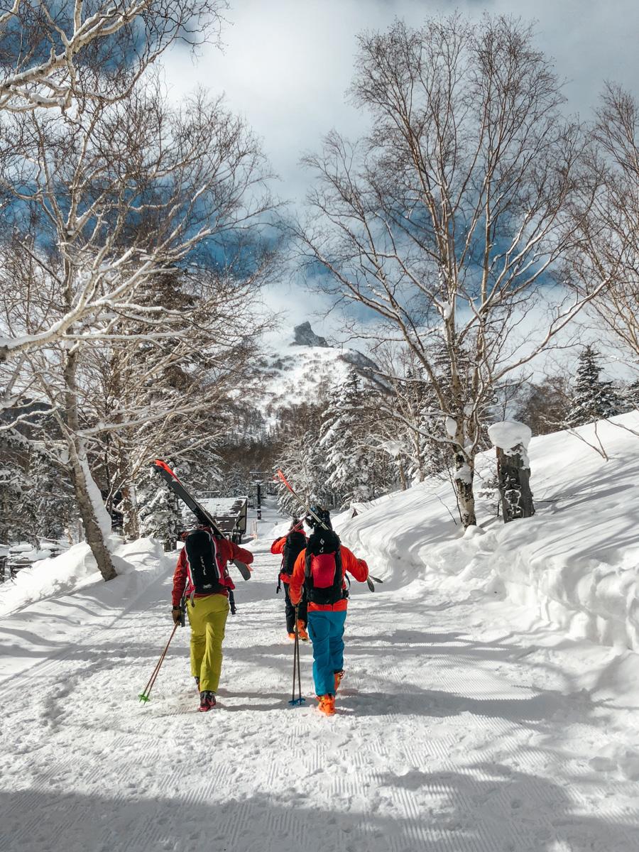 bryon friedman josh donlan walking to hike mount kurodake hokkaide japan.jpg