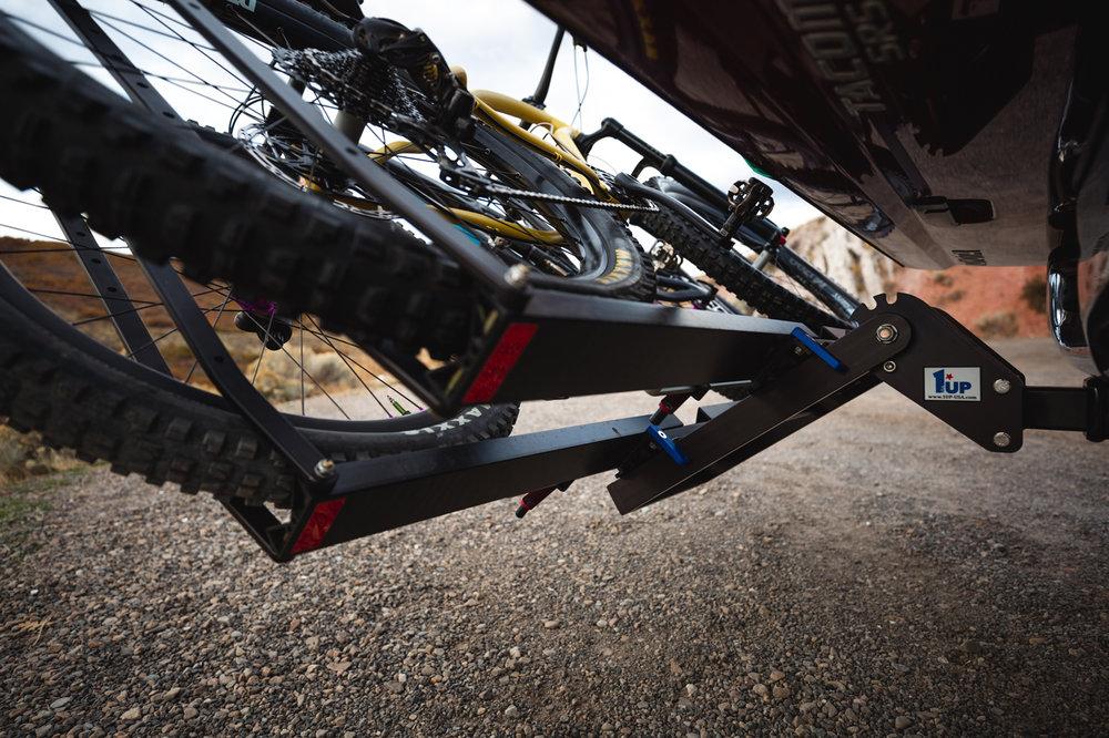 1up-usa-heavy-duty-double-black-bike-rack-pivot-sklar-toyota-tacoma-underneath-logo.jpg
