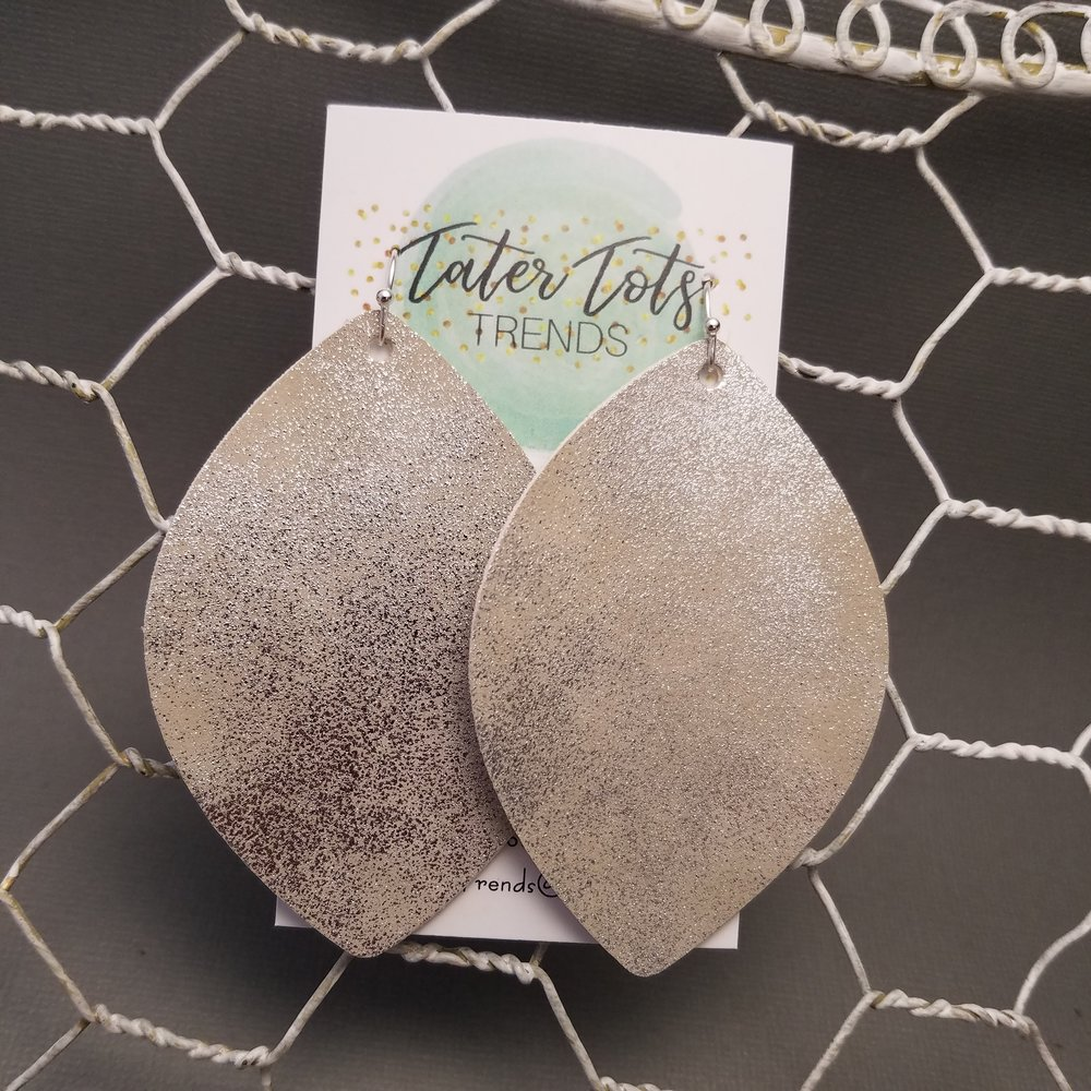Leaf Drop Earrings by Tater Tots Trends - Leaf Drop Earrings are the newest shape to hit their light-weight and stylish jewelry collection. You will not only turn heads in these beauties, but you will be amazed at how feather light they are! Big earrings are back in style and you can wear theirs with comfort, as all of their hardware is nickel free for sensitive ears.Price: $7.75