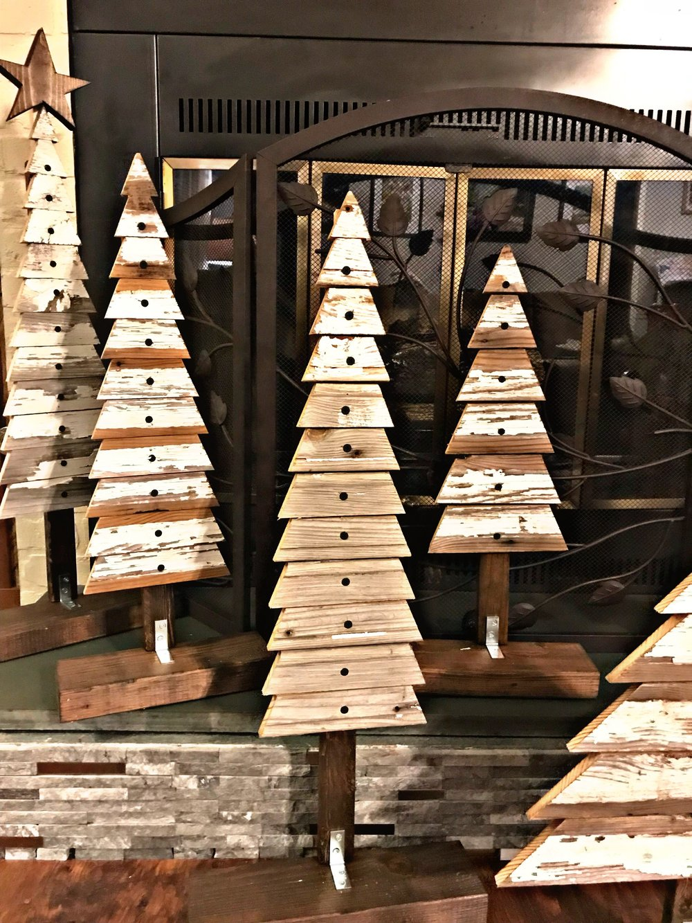 Christmas Tree by The Sandman Collective - Just in time for your holiday decorating, these rustic Christmas trees made from reclaimed shiplap are the perfect compliment to your decor. Available in three sizes: small, medium, or large. Check them out on their Facebook page and message them with your order!Price: $15 for small, $20 for medium, & $25 for large with star