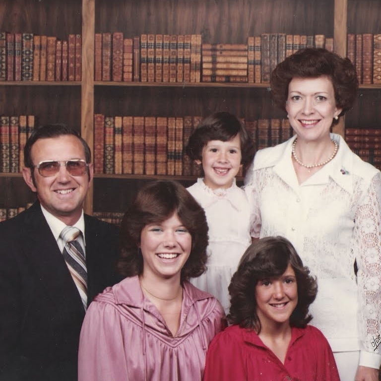 olan mills, 1979. I am the youngest of three girls. A few things I need to clarify. Yes--we were incredibly wealthy as demonstrated by the library of leather bound books. No--my dad did not forget to take off his sunglasses. they looked like that 24 hours a day. no--my sisters were not extras on the set of saturday night fever but my sister Lauren and I did have a bee gee's staying alive poster that hung in our room.