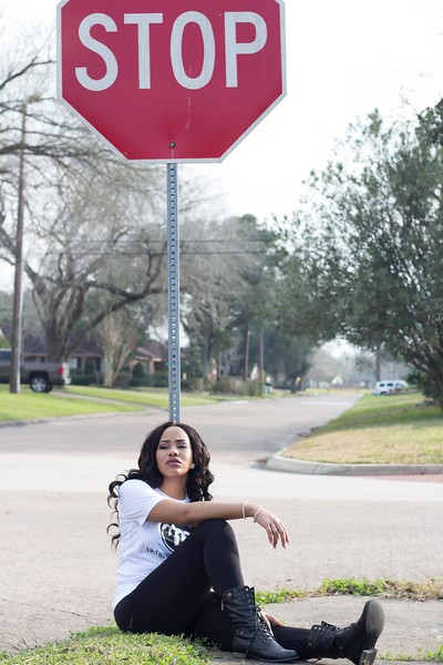 Maranda honors her father's memory at the stop sign on the corner of Santa Teresa and Tidewater, where the life of Randy Evans was taken by his girlfriend.