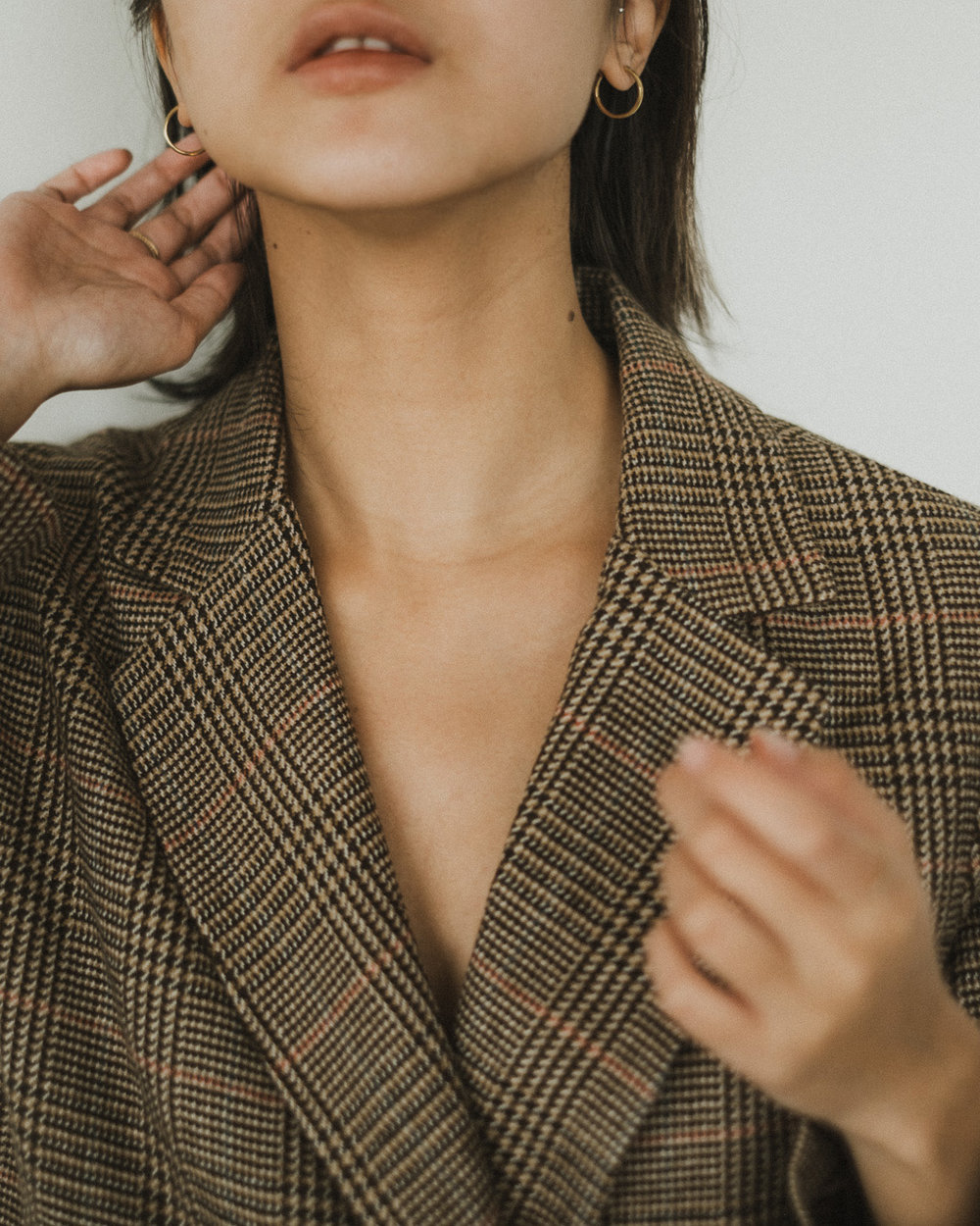 Wearing  | Oak and Fort  Blazer , Mejuri  Open Diamond Ring ,  Beaded Ring ,  Diamond Solo Ring , &  Midi Hoops
