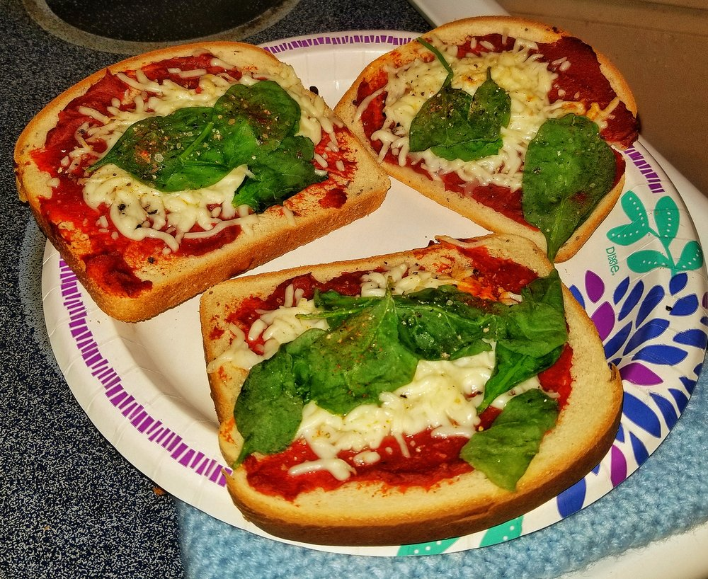 Mini Rye Bread Pizza - These little Buggers are amazing! Ingredients: Tomato PasteMozzarella CheeseSpinach LeavesPink Himalayan Rock SaltFresh Ground Pepper Cayenne PepperRye BreadInstructions:Preheat Oven for 420.Cook for 10 minutes on Pizza Tray.Remove From Oven.Enjoy.