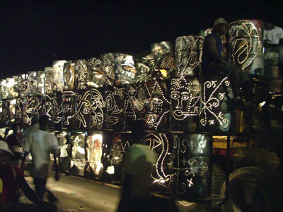 from their page: the Atis Rezistance 2006 Mardi Gras float made from over a hundred metal oil drums lit from within, beautiful masks and Vodou veves