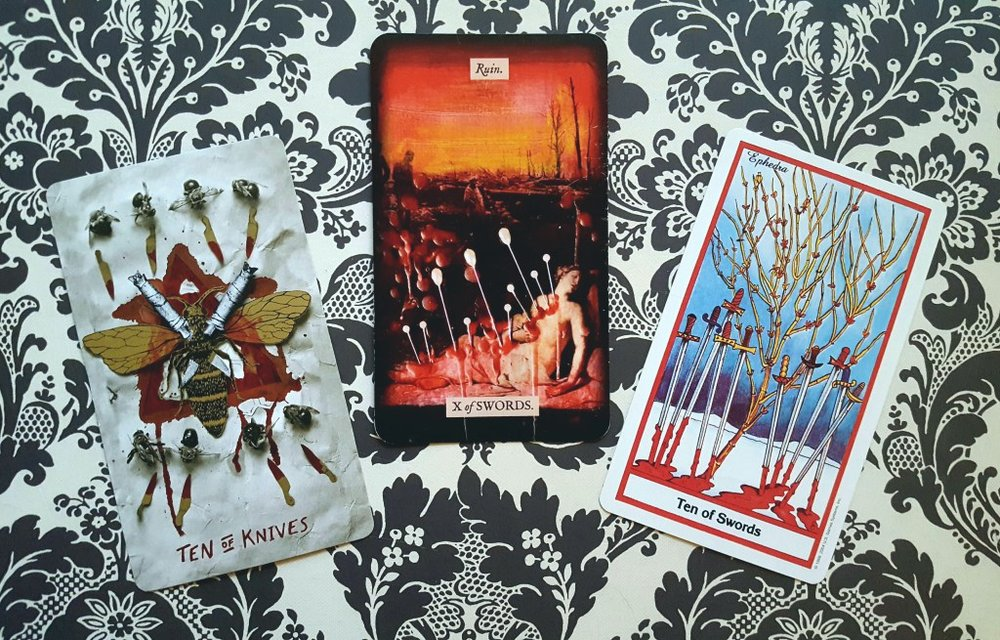 Ten of Swords (Slow Holler, Stretch, Herbal tarot decks)