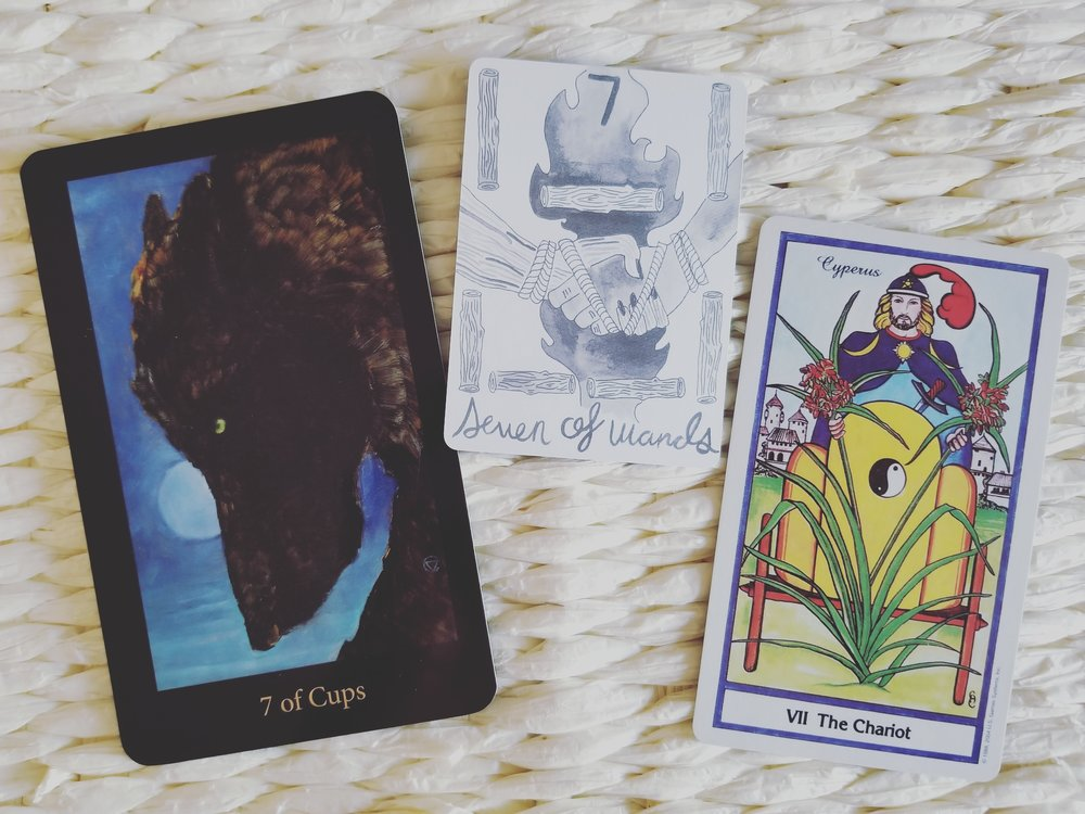 Sevens from the Mary-El, Divina, and Herbal Tarot