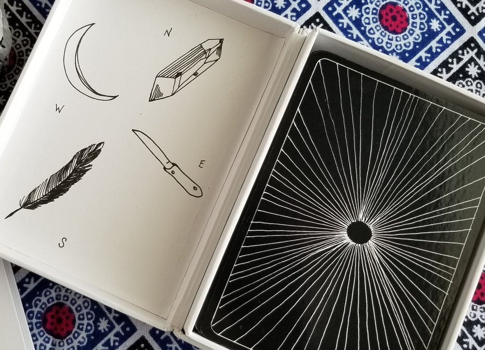 The Wanderer's Tarot box, with its very back to basics representation of the suits and the portal of Tarot