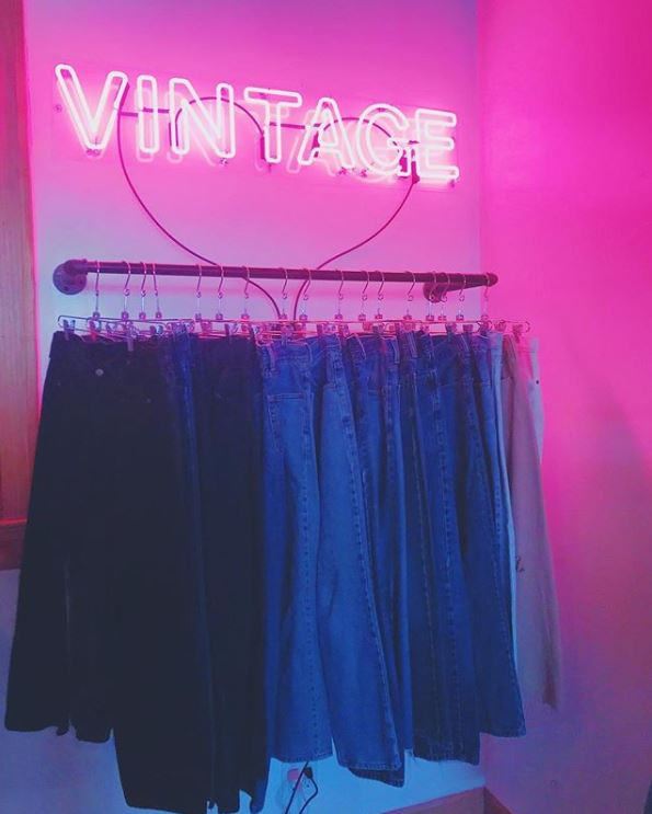 Head toward the neon sign in the back of the shop to find the perfect pair of vintage Levis.