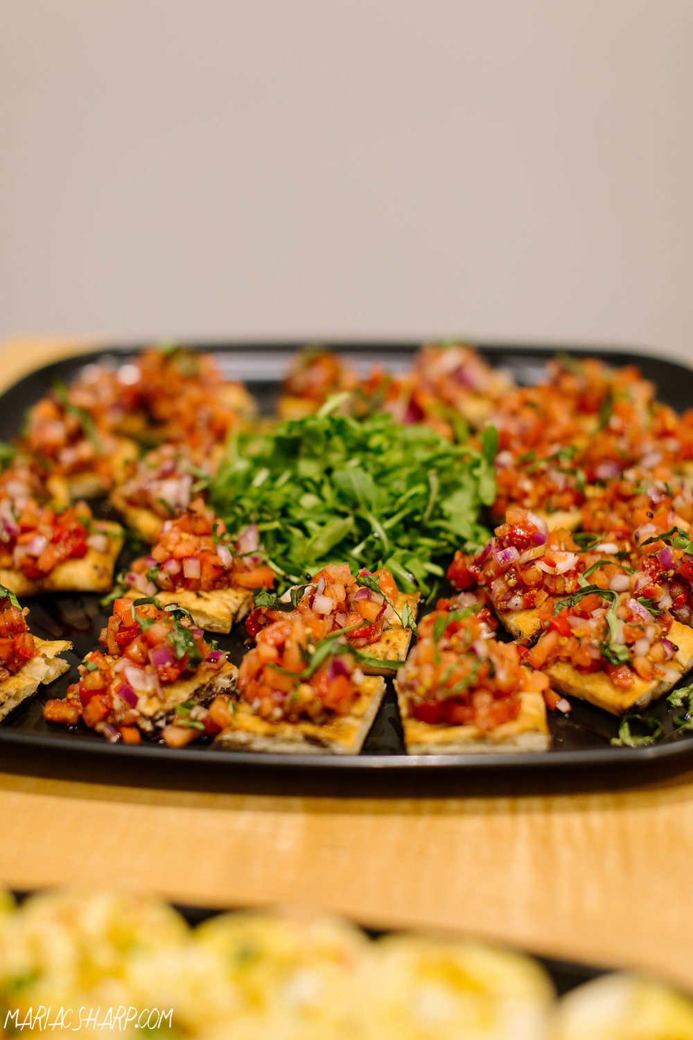The food was catered by Heck's Express, including this delicious platter of bruschetta. Photo by Maria Sharp Photography