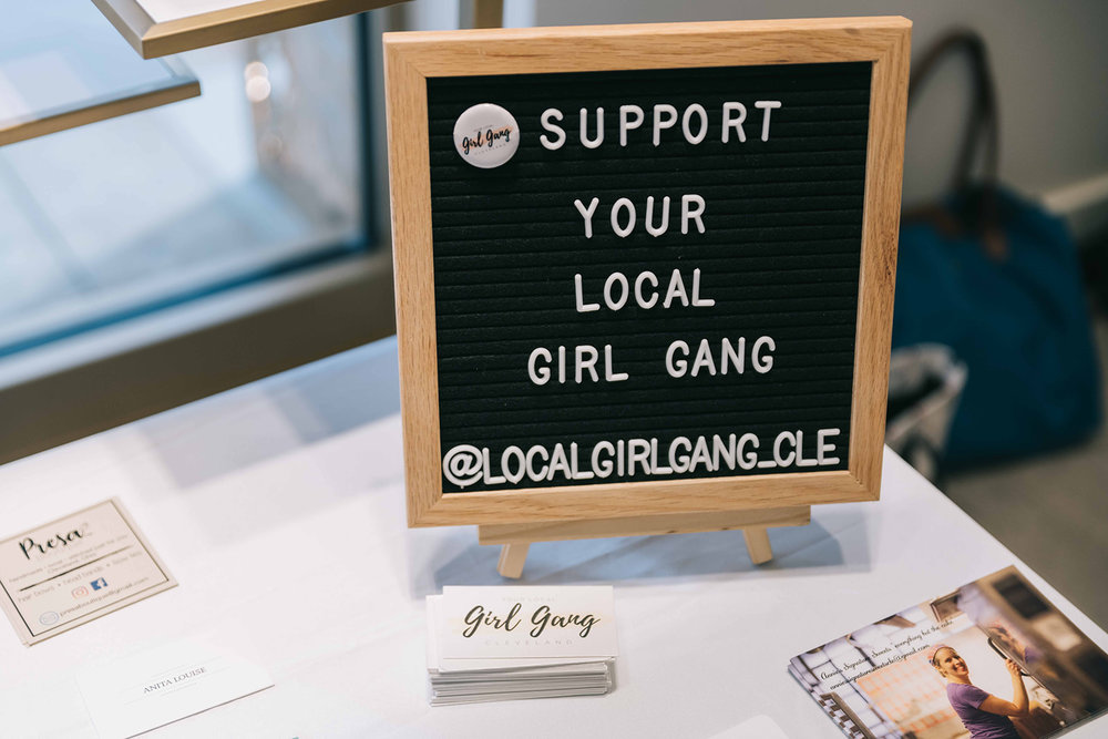 The community table is always full of business cards from entrepreneurs and business owners at the event.  Photo by Anita Louise Photography