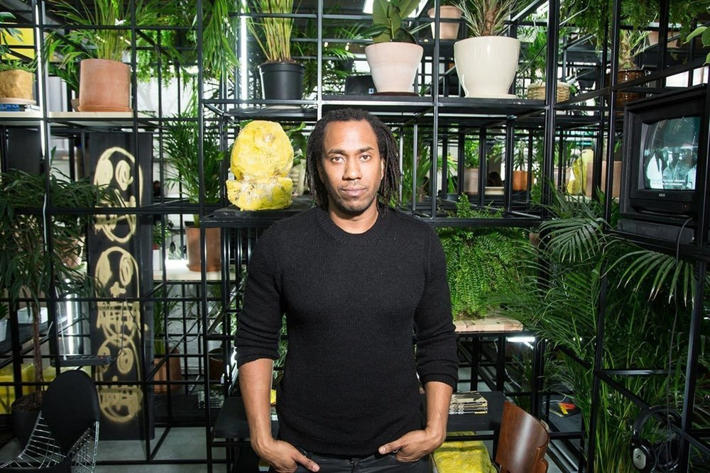 Pic of the artist Rashid Johnson standing in front of his installation