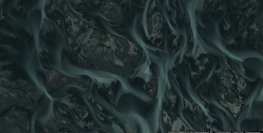 dark grey and green rivers flowing and merging