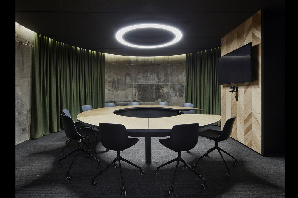 Inside the round concrete bunker meeting room at Slack offices in Melbourne