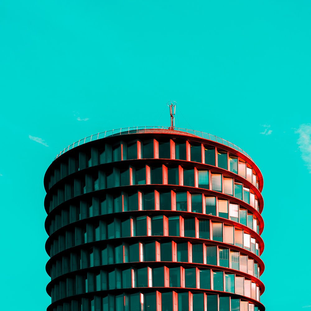 Red round building in hamburg with green sky on the background