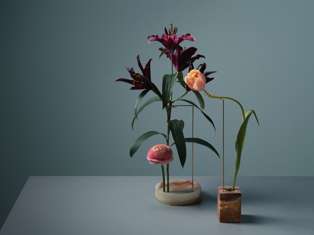 Minimalistic flower design with marble bases and steel
