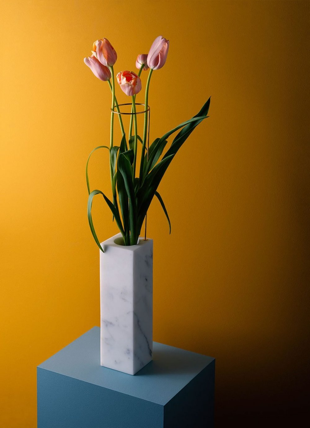 Marble vase and flower design on yellow background