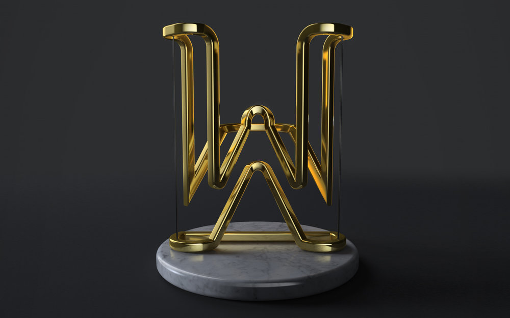Three dimensional typography by  Andreas Wannerstedt: letter W in gold