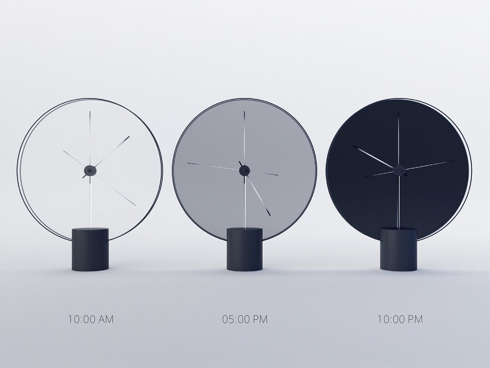3 clocks by Yicong Lu showing different times of the day and corresponding colours of the face