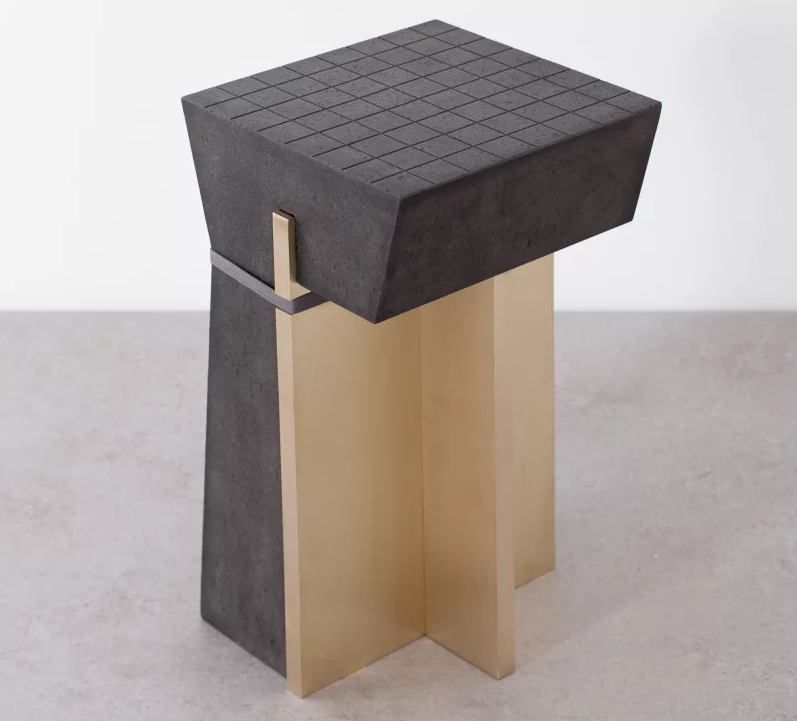 Stool of lava rock and brass by formafantasma