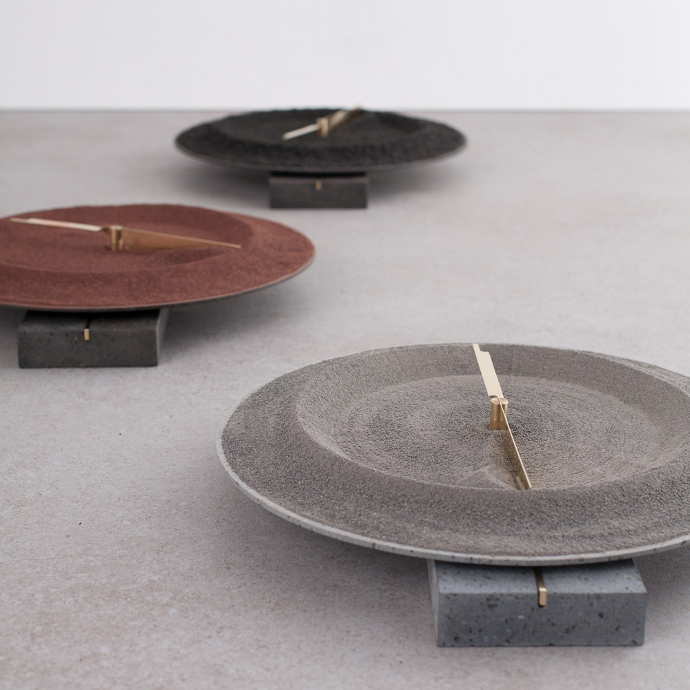 Triple clock with lava sand by formafantasma