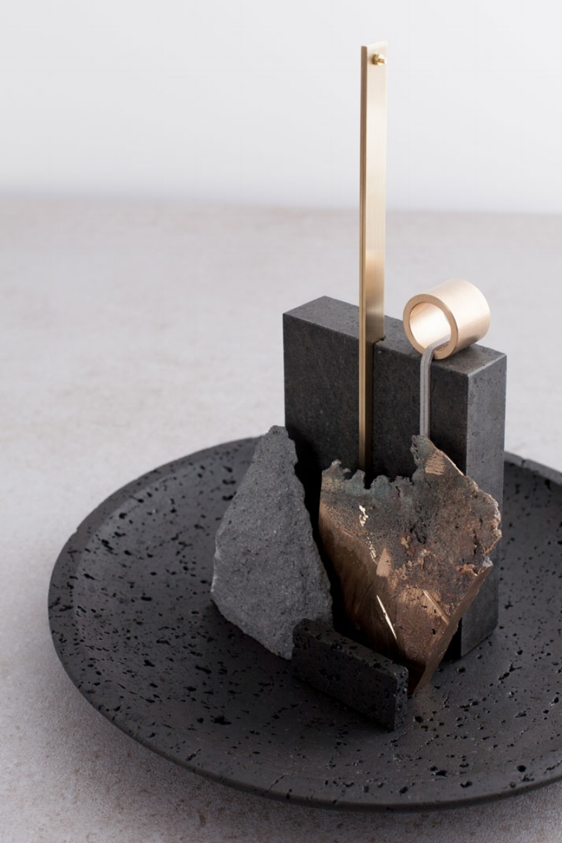Artistic bowl made of lava rock and brass