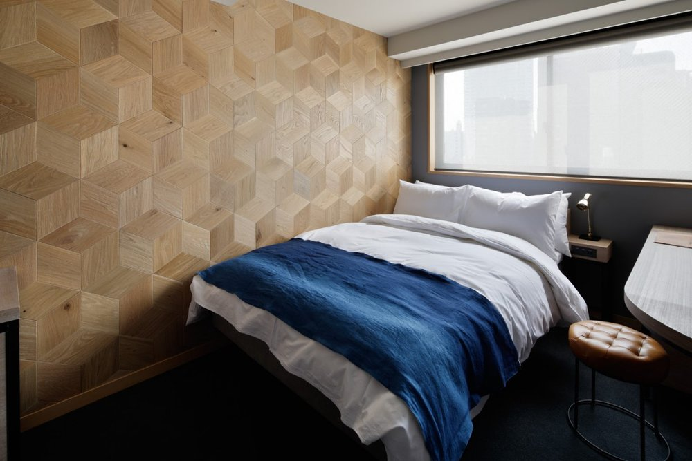 Wooden wallpaper in single room at Wired Hotel
