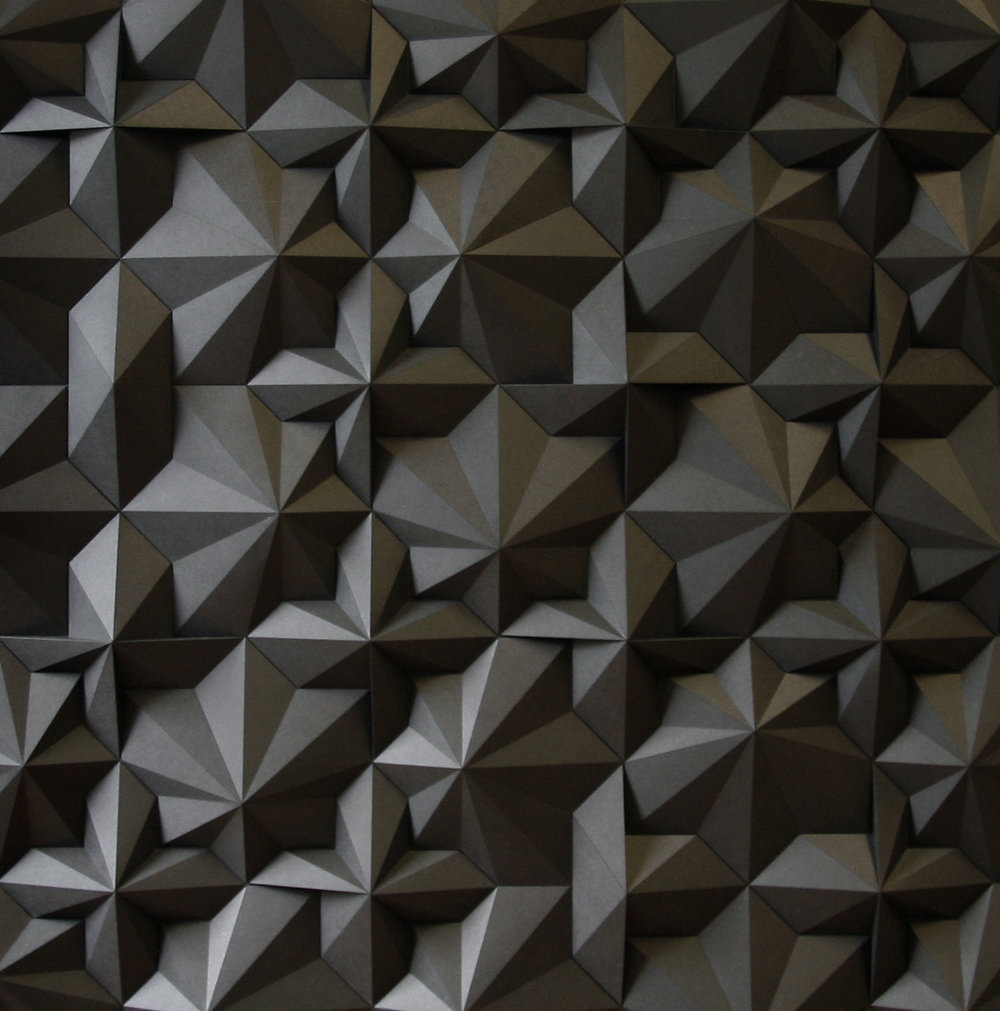 Dark geometric paper sculpture by artist Matthew Shlian