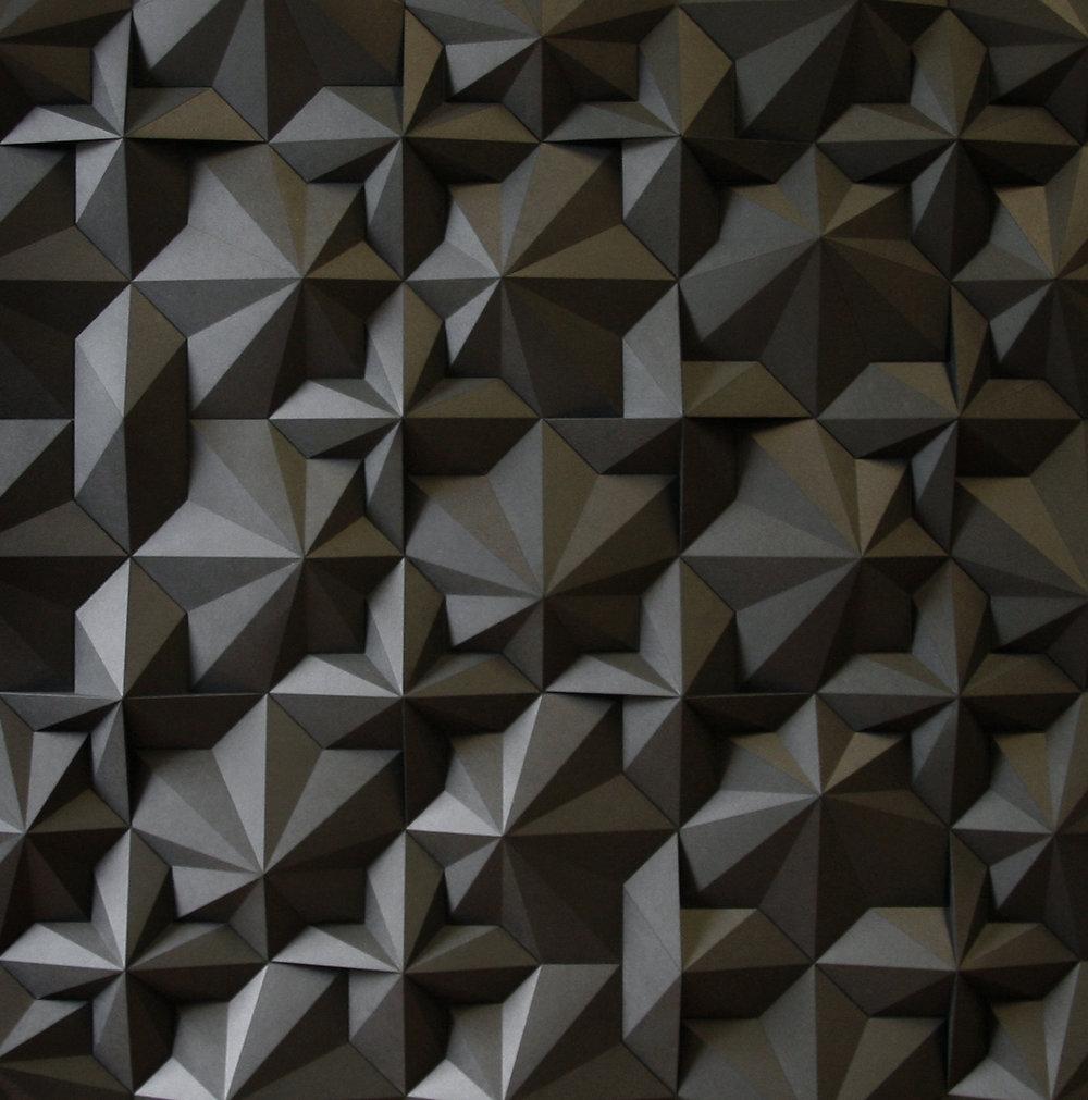 Dark geometric paper sculpture by artist Matthew Shlian
