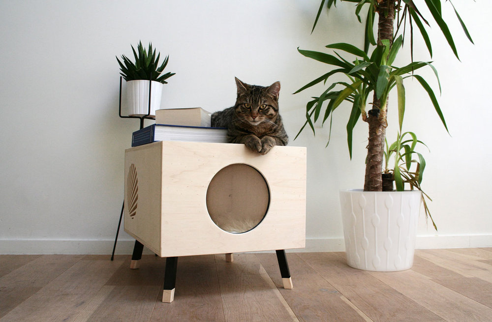 Multi functional piece: pet bed and side table made of plywood.