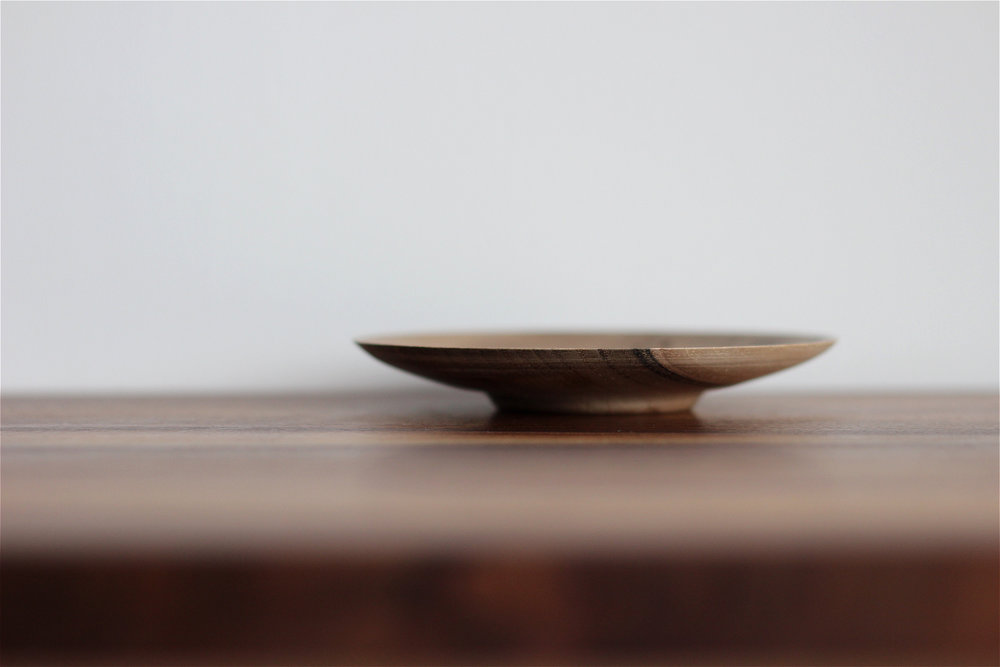 Coffee stained small plate made of walnut wood by Magda Majnusz