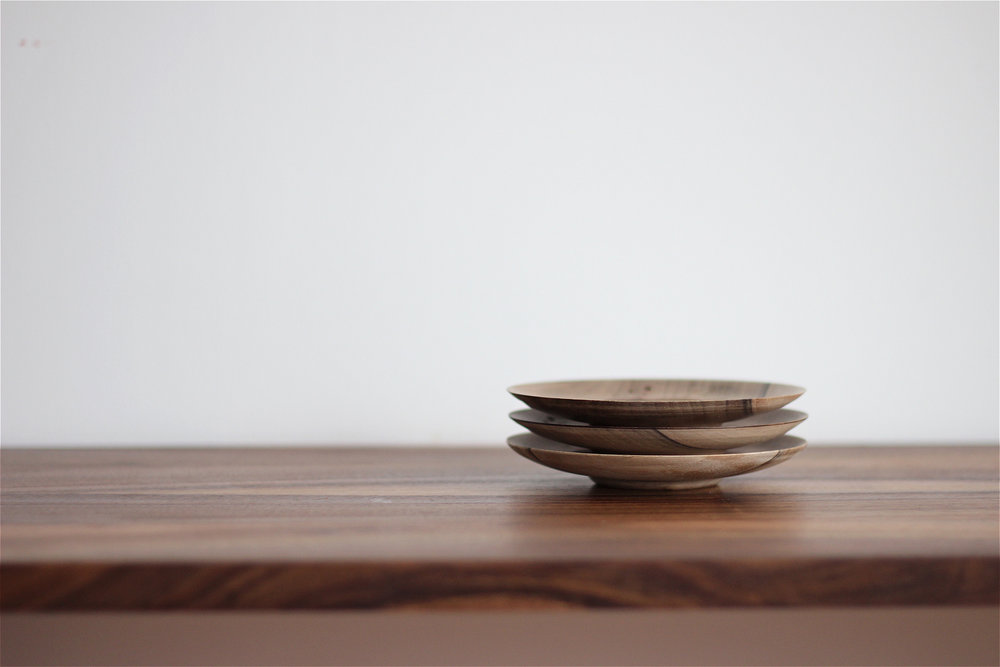 Stack of small wooden plates
