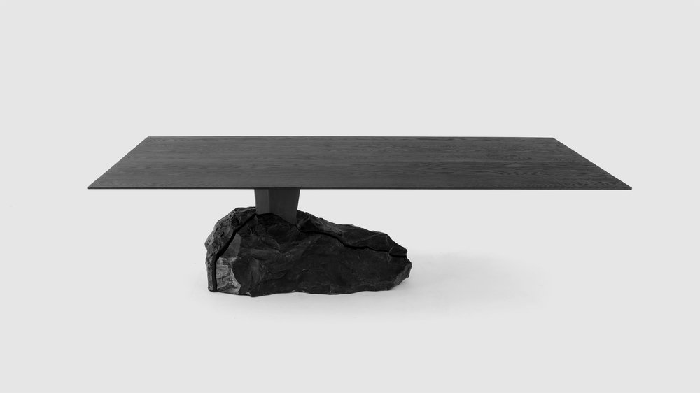 The wooden countertop is burnt through a Japanese technique known as Yakisugi.