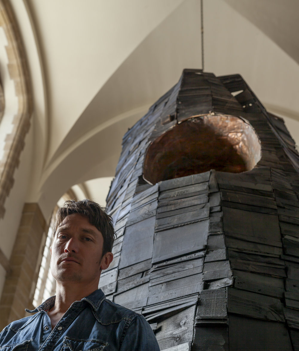 Artist Chris Jenkins  - with 'The Monolith' at Portsmouth Cathedral   (photo by Julian Winslow)