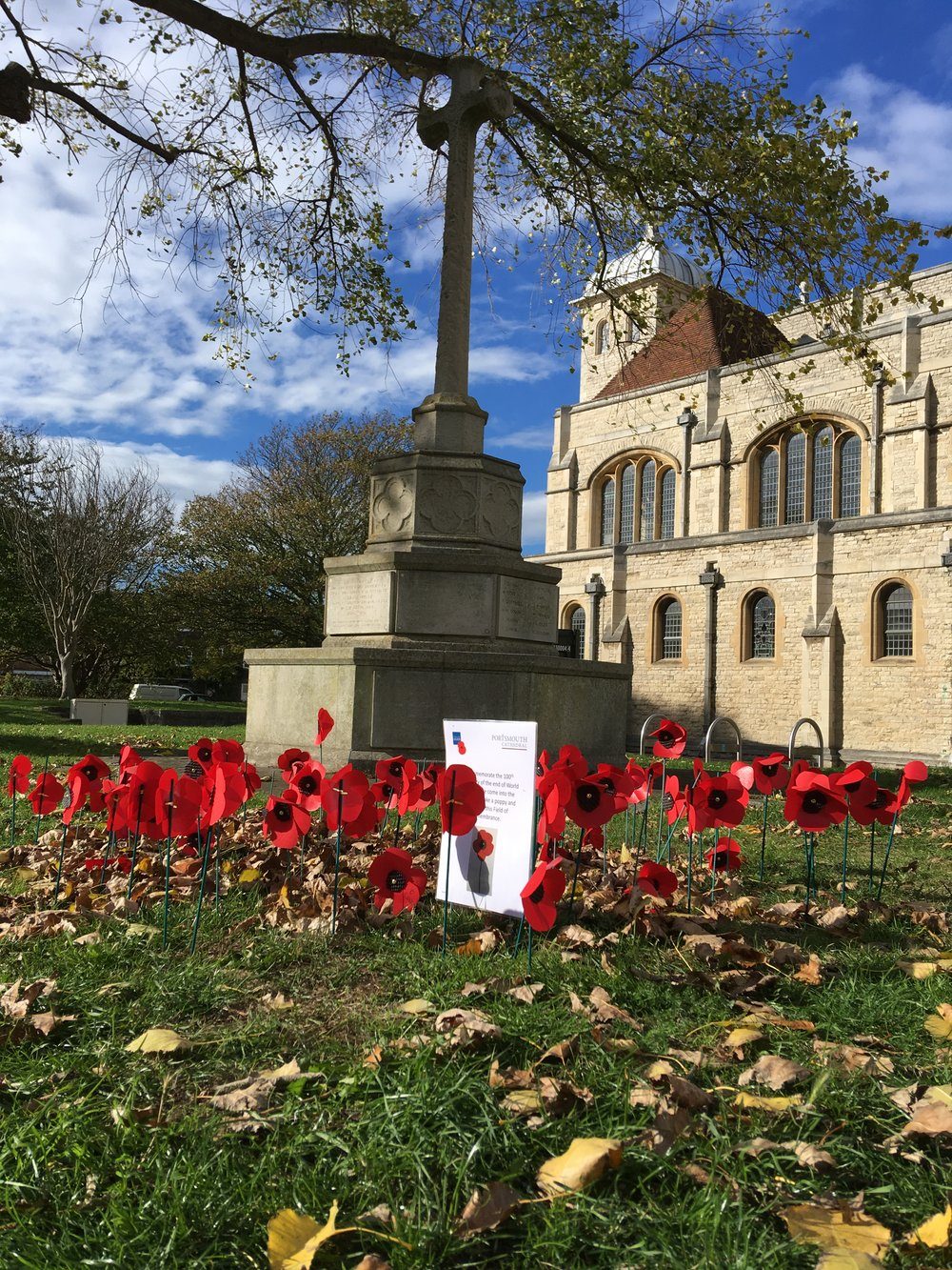 Poppies made at the Cathedral are being placed at the foot of the War Memorial in Old Portsmouth.