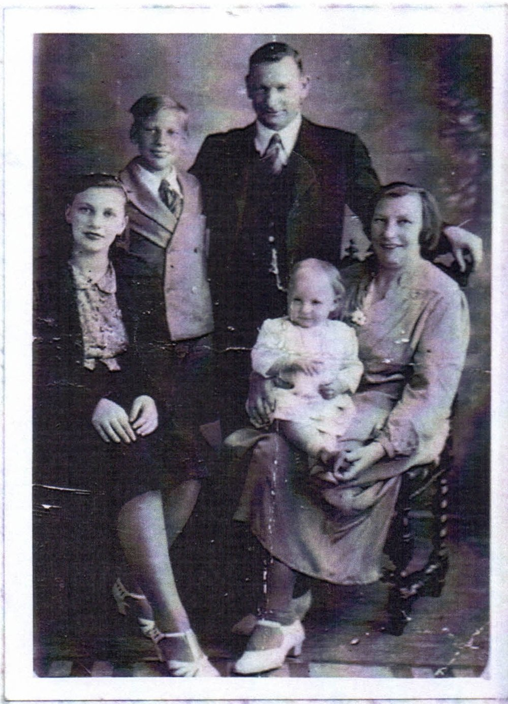 W.T. Booth and family - David's grandfather Tom is standing at the back. David's late mother Doreen is sitting on his Grandmother Elsie's knee. Far left are David's Aunt Rene next to brother, David's Uncle Bill. (Credit: David Yates)