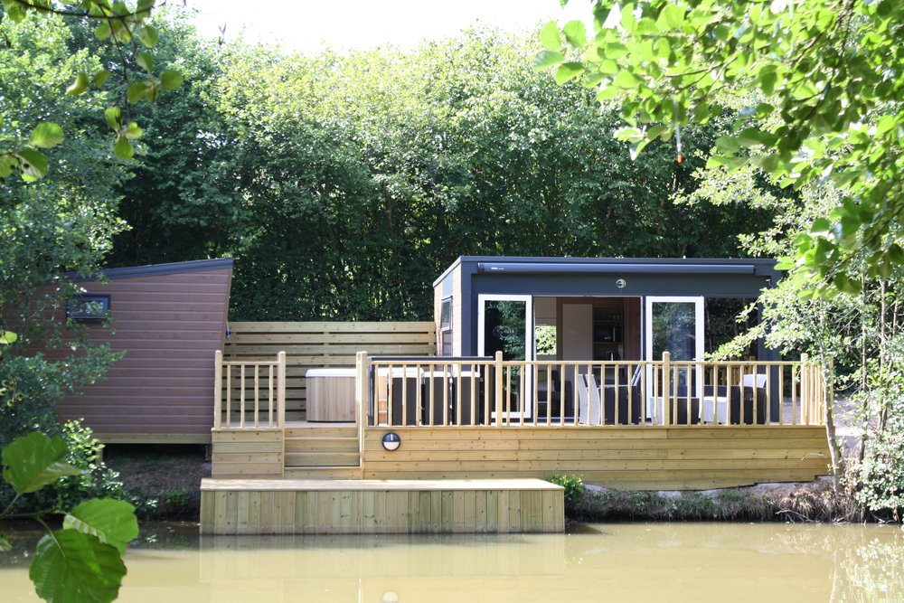 Pochard - Two separate fully fitted cabins that include bathroom with shower and toilet, 2 living room with sofa that turns into super comfy double bed, bunk bed, TV's , kitchen fitted with oven, gas hob, sink, microwave and fridges..Comes with all linen & towelsOutside space includes private hot tub, table and chairs and relaxing furniture for 6 plus BBQ areafishing from deck permitted on private lake