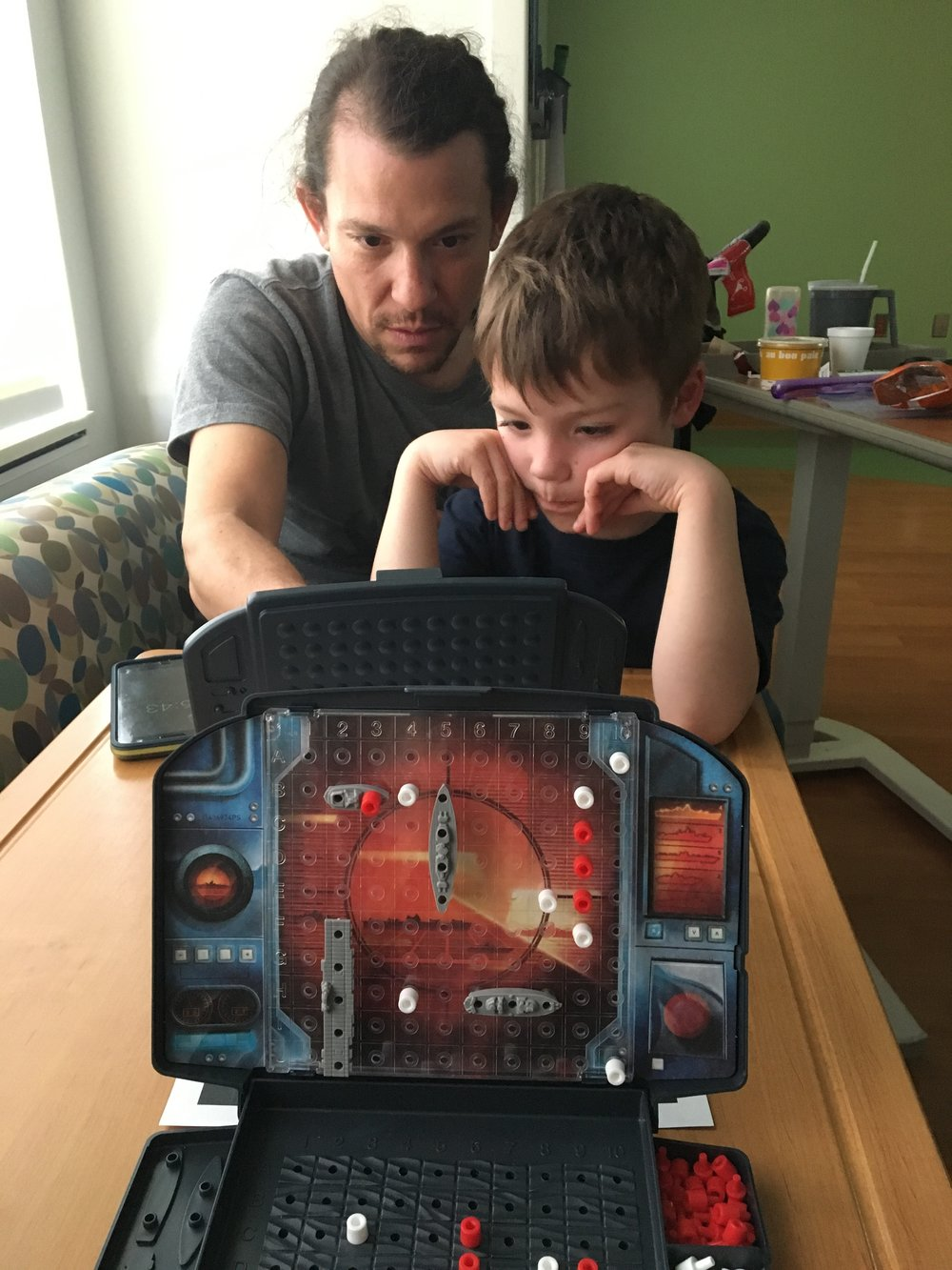 Getting our battleship on with Daddy during an inpatient stay