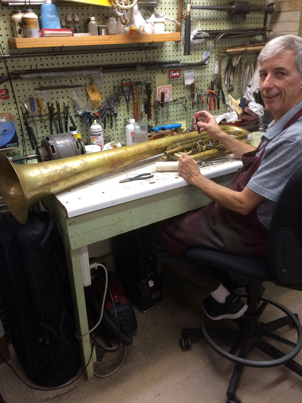 Master Technician Working On 1866 Sax Horn