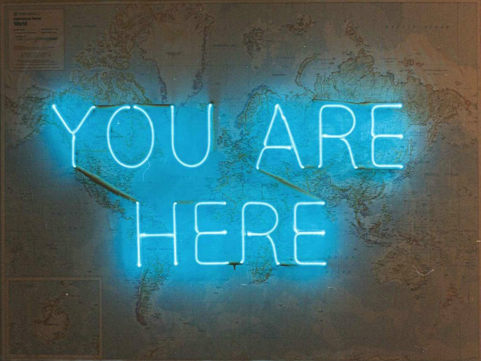 you are here neon sign.jpg