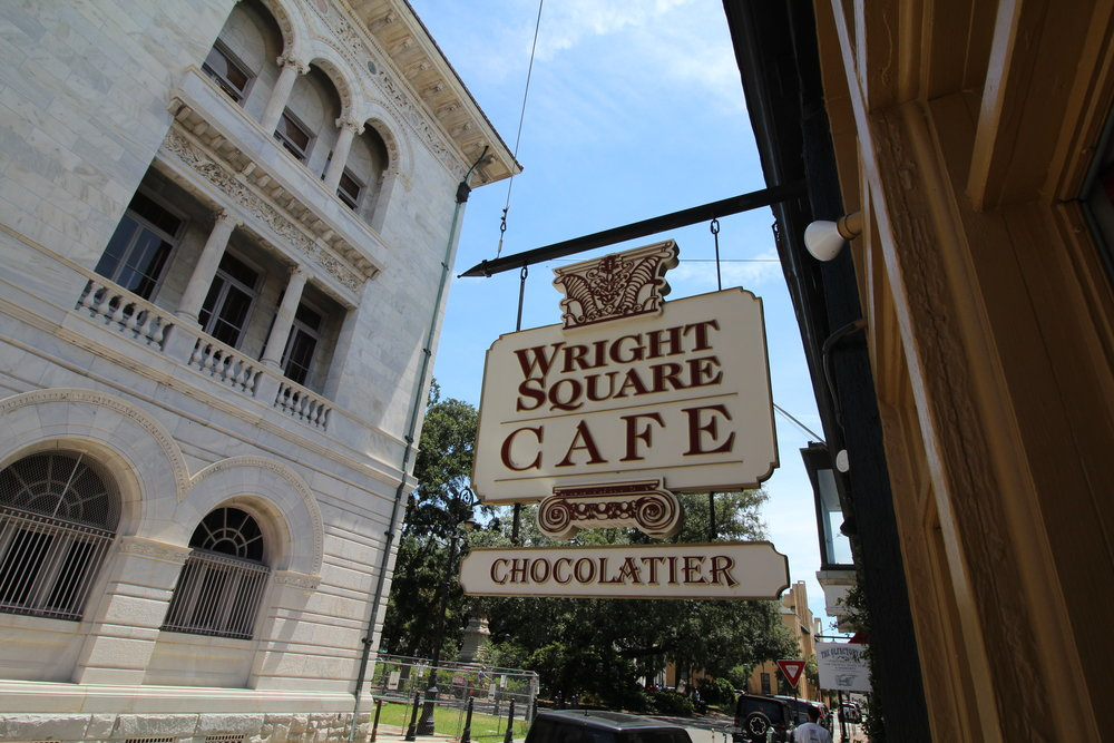 A Gourmet Cafe & gift shop - Located in Downtown Savannah for 16 years, Wright Square Cafe is a staple lunch spot for both locals and tourist. Offering fresh sandwiches, wraps, sides, and tasty treats, Wright Square has something for everyone. Come in and enjoy the relaxing sitting area with some lunch or chocolates. Both if you're up to it!