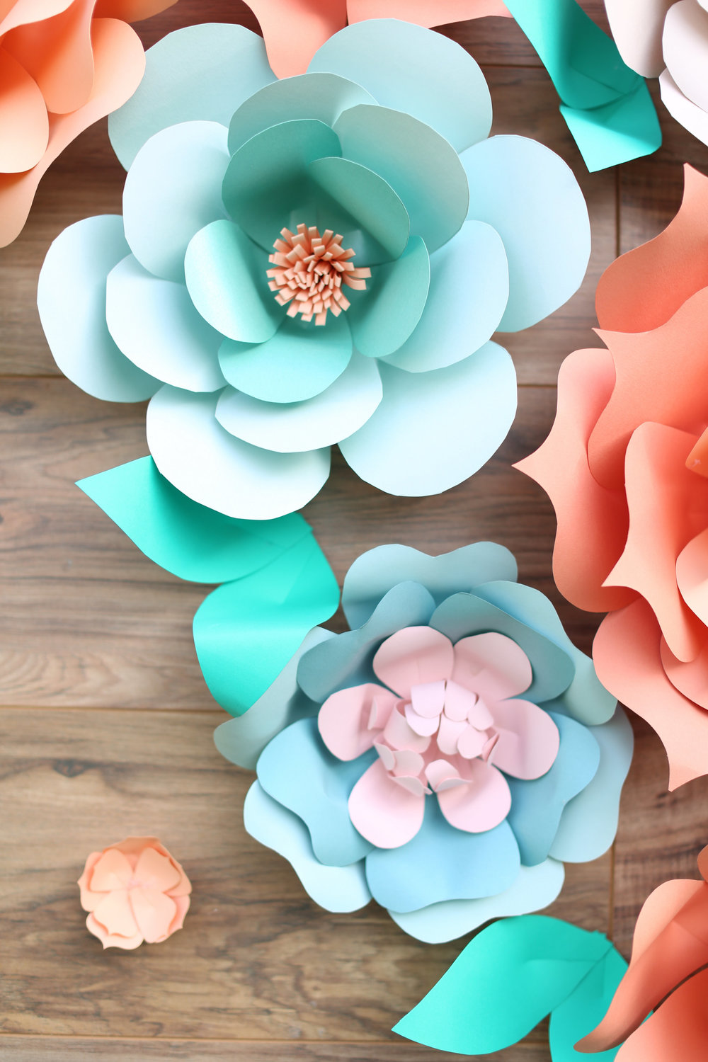 rustic giant paper flower backdrop_rustic wood backdrop_ pallette backdrop_peach and teal giant paper flower backdrop_ peach wedding dessert decor_ peach and teal wedding decor ideas_ unique rustic decor 1.jpg