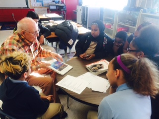 Dr. Richard Gentile, Professor Emeritus at the UMKC School of Geology and Paleontological Institute, visited our STEM students to discuss the book he authored on prehistoric Kansas City. Egan, sitting to Dr. Gentile's right, wants to be a paleontologist.